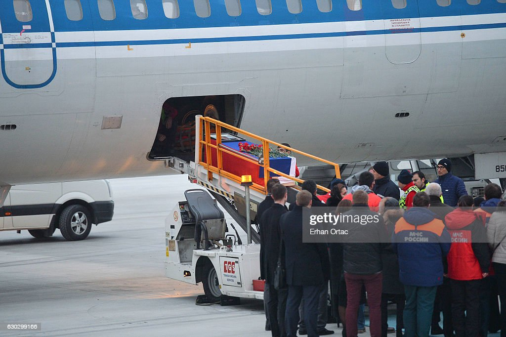 The flag-wrapped coffin of late Russian Ambassador to Turkey Andrei Karlov is loaded to a plane during a ceremony at Esenboga airport on December 20, 2016 in Ankara. Turkey. Russia's ambassador to Turkey, Andrey Karlov, was shot dead by a Turkish policeman shouting 'Don't forget Aleppo! Don't forget Syria' at an art exhibition in the Turkish capital of Ankara yesterday.
