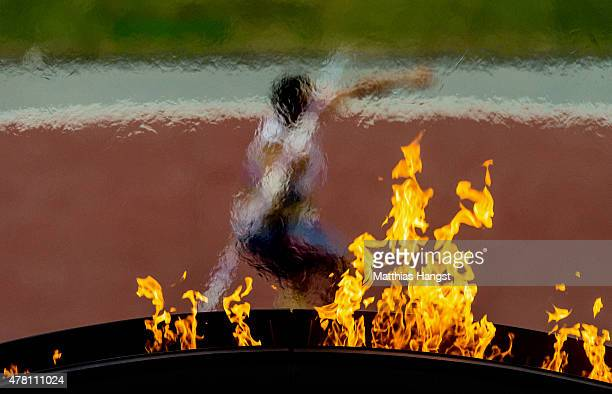 The flame burns as an athlete throws in the Men's Javelin during day ten of the Baku 2015 European Games at the Olympic Stadium on June 22 2015 in...