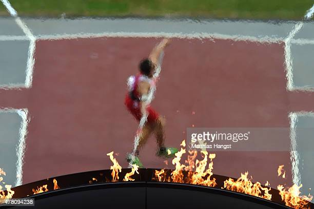 The flame burns as Bradley Mifsud of Malta throws in the Men's Javelin during day ten of the Baku 2015 European Games at the Olympic Stadium on June...