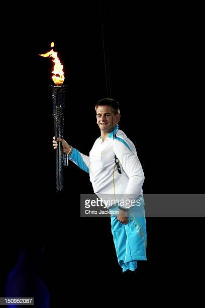 The flame is carried by Royal Marine Joe Townsend during the Opening Ceremony of the London 2012 Paralympics at the Olympic Stadium on August 29,...