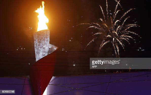 The flame of the 2008 Beijing Paralympic Games is lit during opening ceremony at the National Stadium better known as the Bird's Nest in Beijing on...