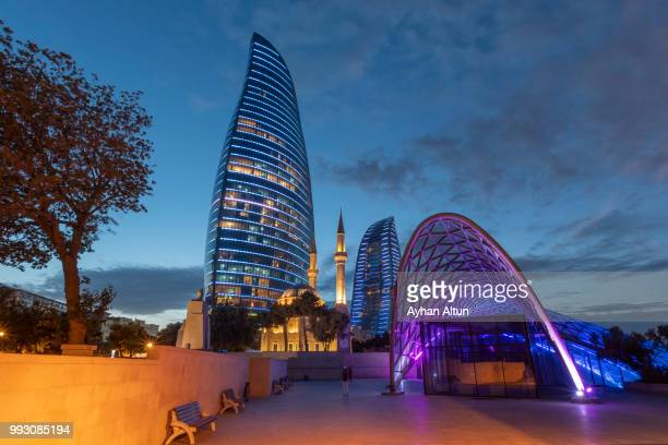 the flame towers and funicular station at night  in baku,azerbaijan - baku stock pictures, royalty-free photos & images