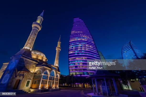 The Flame Towers and Sehidler Xiyabani Mosque at night  in Baku,Azerbaijan