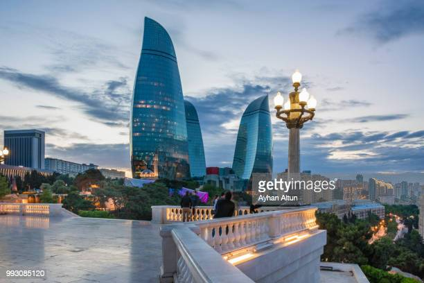the flame towers at night seen from the dagustu park in baku,azerbaijan - バクー ストックフォトと画像