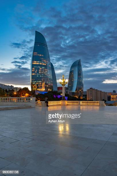 the flame towers at night seen from the dagustu park in baku,azerbaijan - azerbaijan stock pictures, royalty-free photos & images
