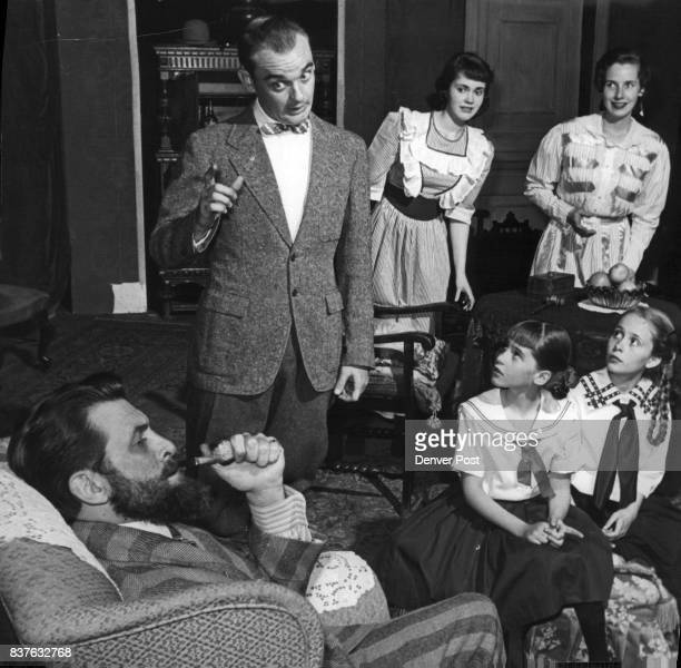 The Flannigan family following parliamentary procedure discusses a vital issue with the Pater familias Jerry Gough in this scene from the Loud Red...