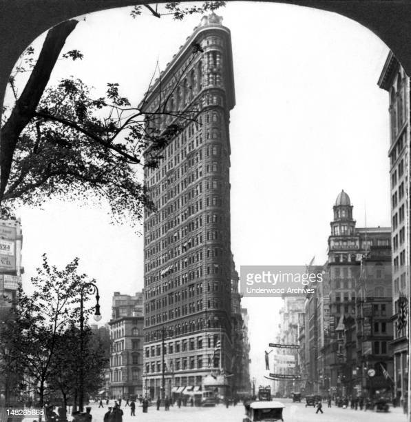The Flatiron Building at Fifth Avenue and Broadway at the south end of Madison Square in New York City New York New York circa 1912 It is 22 stories...