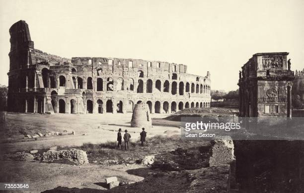 The Flavian Amphitheatre or Colosseum in Rome with the Arch of Constantine on the right and Meta Sudans in the centre circa 1865
