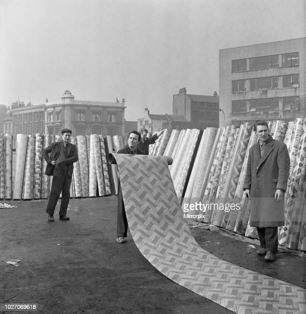 The flea market at Club Row, Bethnal Green, E2 London 1st March 1955 Linoleum salesmen set up their market stall at the flea market at Club Row,...