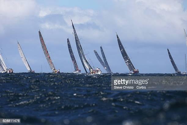 The fleet head for Hobart outside the Sydney Heads during the race start Sydney Australia Thursday 26th December 2013