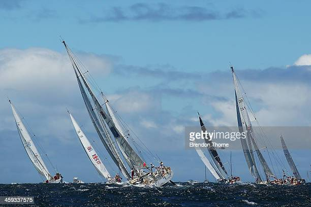 The fleet heads out to sea during the 2013 Sydney to Hobart yacht race on December 26 2013 in Sydney Australia