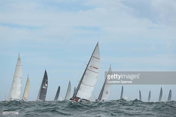 The fleet heads out to sea during the 2015 Sydney to Hobart on December 26 2015 in Sydney Australia