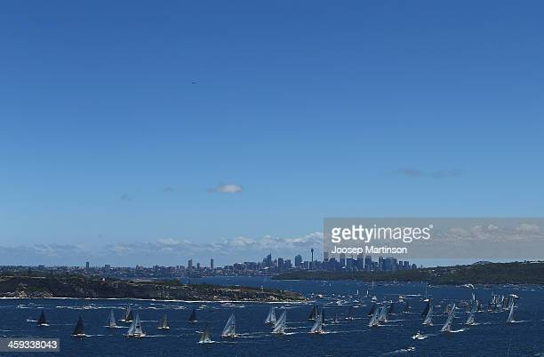 The fleet moves away from the start line during the 2013 Sydney to Hobart on December 26 2013 in Sydney Australia