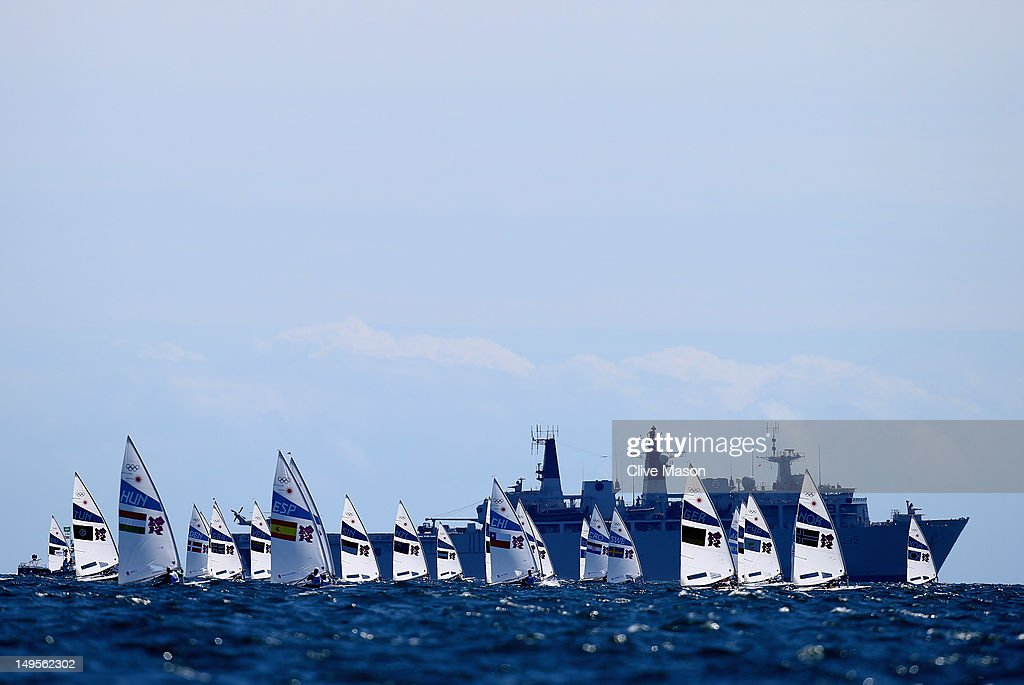 The fleets prepares to compete in the Men's Laser Sailing on Day 3 of the London 2012 Olympic Games at Weymouth Harbour on July 30, 2012 in Weymouth, England.