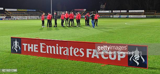 The Fleetwood Town players inspect the pitch before the game during the The Emirates FA Cup First Round match between Southport and Fleetwood Town at...