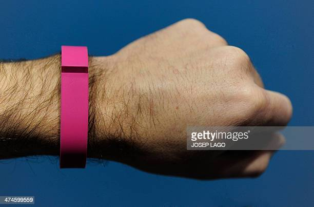 The 'Flex' an 'electronic coach' device by Fitbit is presented at the Mobile World Congress in Barcelona on February 24 2014 The Mobile World...