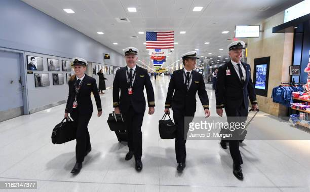 The flight crew and cabin crew of QF7879 from New York to Sydney on October 18 2019 in New York NY Qantas is the first commercial airline to ever fly...