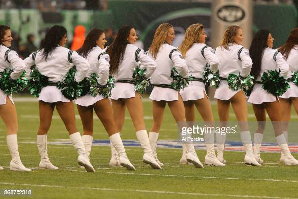 The FLight Crew cheerleaders of the New York Jets in action during the game against the Atlanta Falcons in a heavy rain storm during their game at...