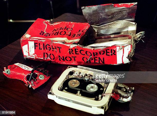 The flight data recorder from Alaska Airlines Flight 261 sits on a table in front of National Transportation Safety Board Chairman Jim Hall during a...