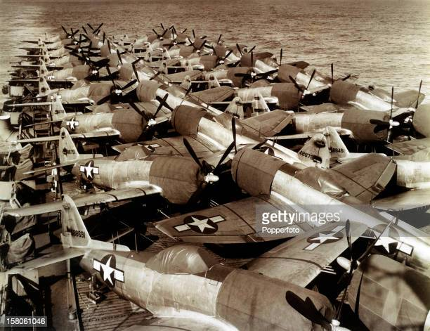 The flight deck of the aircraft carrier USS Casablanca filled with P47s en route for Guam during World War Two circa July 1945 This image is from the...