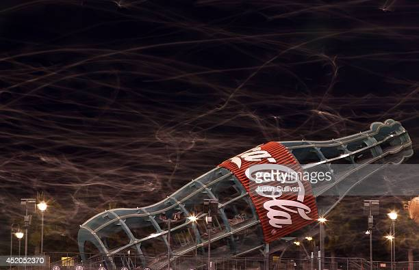The flight paths of seagulls are seen in a time exposure as they fly over the left field bleachers at the conclusion of the San Francisco Giants...