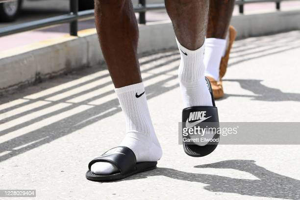 The flip flops of LeBron James of the Los Angeles Lakers before the game against the Sacramento Kings on August 13 2020 in Orlando Florida at...