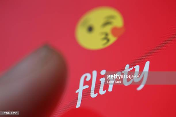 "The ""Flirty"" app logo is seen on a mobile phone screen on November 24, 2016 in London, England. Following a number of deaths linked to the use of..."