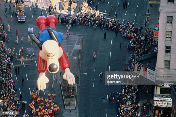 The float of the cartoon character Underdog hovers over the crowd gathered to watch the annual Thanksgiving Day Parade in New York City