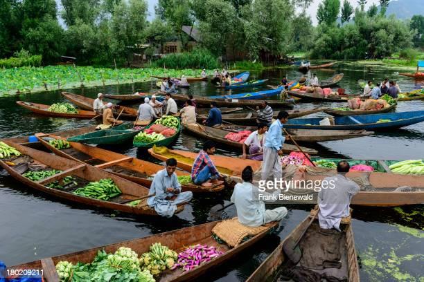 SRINAGAR JAMMU KASHMIR INDIA The 'Floating market' a vegetable market on Dal Lake where vendors sell vegetables from shikara to shikara
