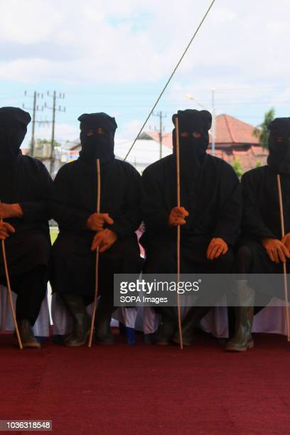 The flogging enforcers seen before whipping the prisoners 19 people were sentenced by the Meulaboh Sharia Court to being whipped in public for...