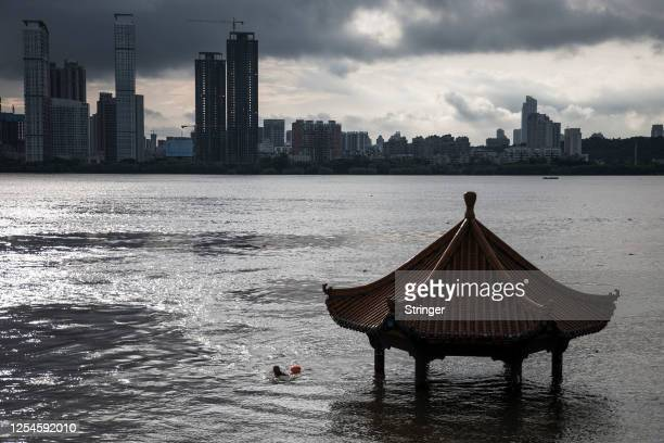 The flood inundated the pavilion beside Yangtze River on July 6, 2020 in Wuhan, Hubei province, China.Wuhan on Monday upgraded its emergency response...