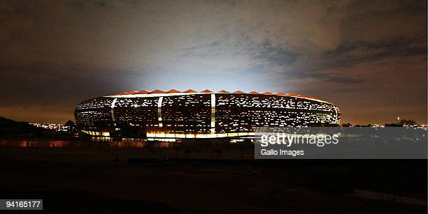 The flood lights of the Soccer City Stadium in Diepkloof are officially switched on December 8, 2009 in Johannesburg, South Africa. Soccer City is...