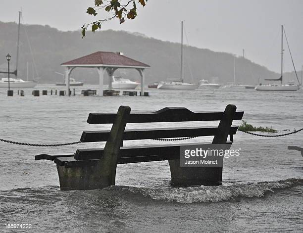 The flood waters begin to rise in Northport Harbor, submerging the dock and waterfront park as Hurricane Sandy closes in. 10-29-12