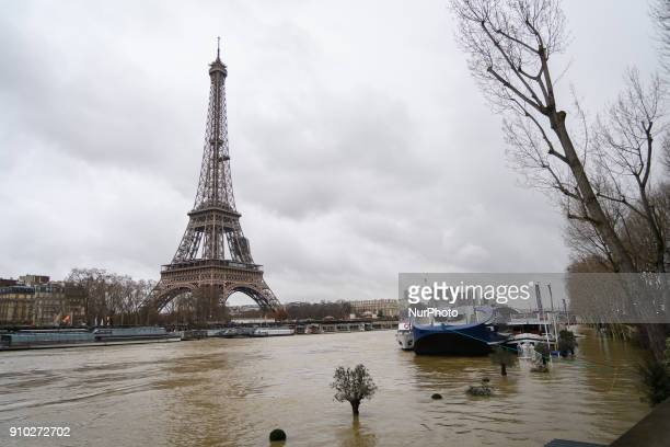 The flooded banks of the Seine river in Paris The Seine continued to rise on January 25 flooding streets and putting museums on an emergency footing...