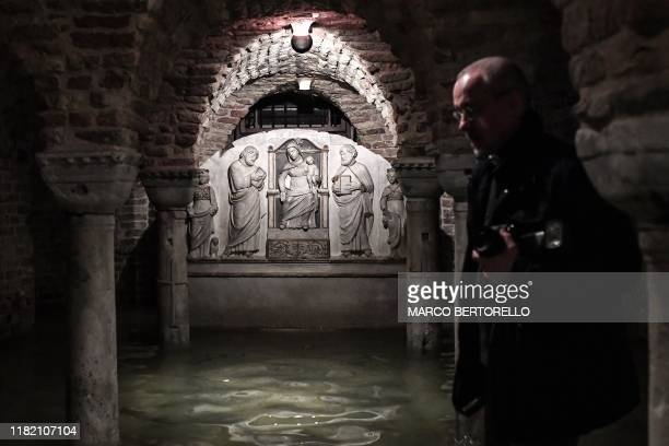 The flooded crypt of St Mark's Basilica is pictured after an exceptional overnight Alta Acqua high tide water level on November 13 2019 in Venice...