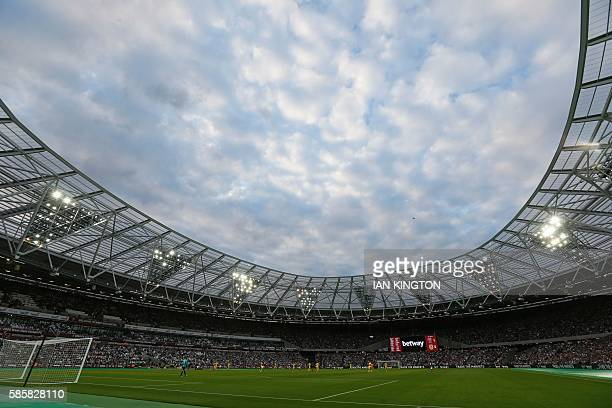 The floodlights are on in the first half during the qualifying third round second leg Europa League football match between West Ham United and NK...