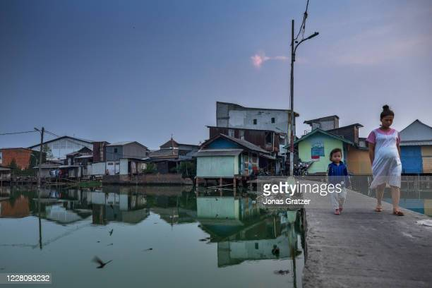 The floodwaters in Kampung Teko, Jakarta, cannot wash out to sea because the area lies below sea level. Jakarta is subsiding at record rates, thanks...