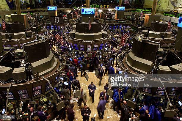 The floor of the New York Stock Exchange is busy with activity January 3 2001 in New York City Stocks roared on Wednesday after the Federal Reserve...