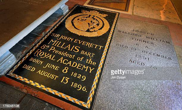 The floor tomb of Pre Raphaelite artist JOHN EVERETT MILLAIS beside that of landscape artist Joseph Mallord William Turner in St Pauls Cathedral's...