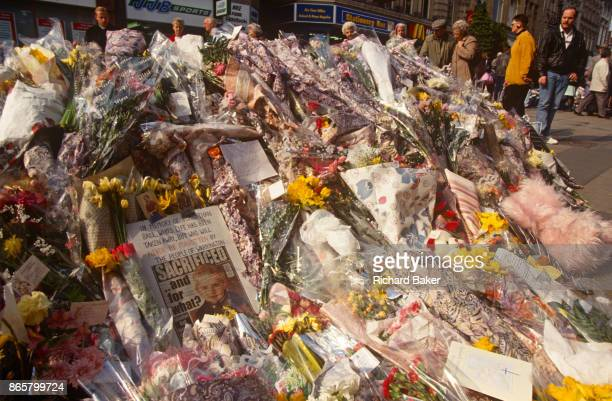 The floral memorial shrine in memory of two young victims killed by an IRA bomb in the centre of Warrington Cheshire England on 27th February 1993 in...
