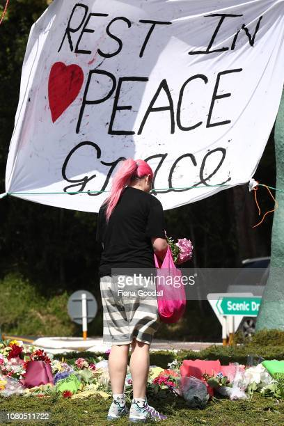The floral tributes at the Titirangi roundabout grow larger for Grace Millane on December 11 2018 in Auckland New Zealand The body of 22yearold Grace...