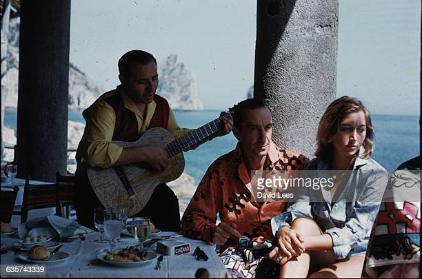 The Florentine fashion designer Emilio Pucci lunching in Capri with his wife Christina Italy 1959 Pucci once had the guitarist who is serenading them...