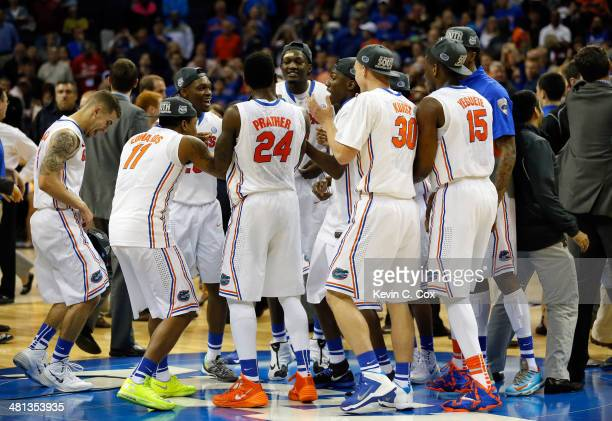 The Florida Gators celebrate on the court after defeating the Dayton Flyers 6252 in the south regional final of the 2014 NCAA Men's Basketball...