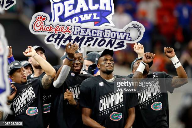The Florida Gators celebrate their teams win over the Michigan Wolverines during the ChickfilA Peach Bowl at MercedesBenz Stadium on December 29 2018...