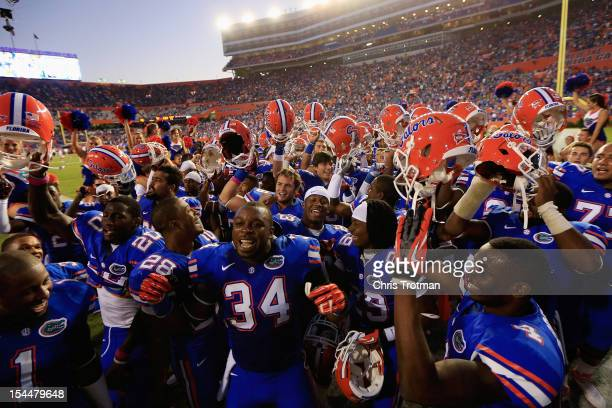 The Florida Gators celebrate their victory over the South Carolina Gamecocks at Ben Hill Griffin Stadium on October 20 2012 in Gainesville Florida...