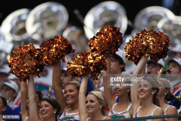 The Florida Gators cheerleaders waver their pompoms during the game against the Michigan Wolverines at ATT Stadium on September 2 2017 in Arlington...