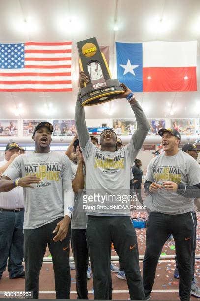 The Florida Gators' Grant Holloway celebrates with team members holding up the National Championship trophy at the conclusion of the 2018 Division I...