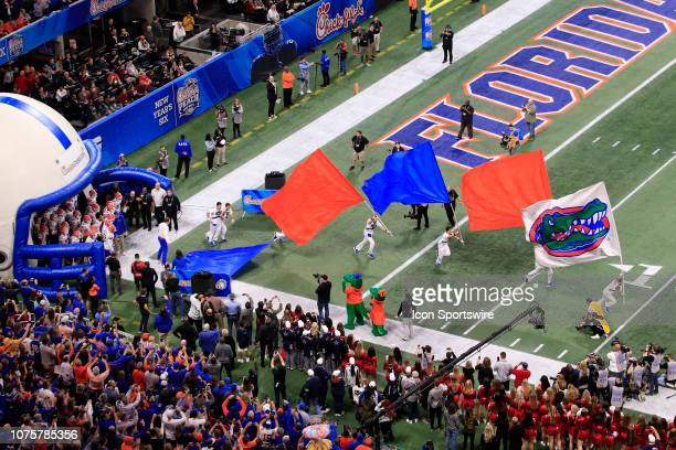 The Florida Gators run onto the field for the Peach Bowl between the Florida Gators and the Michigan Wolverines on December 29 2018 at the...