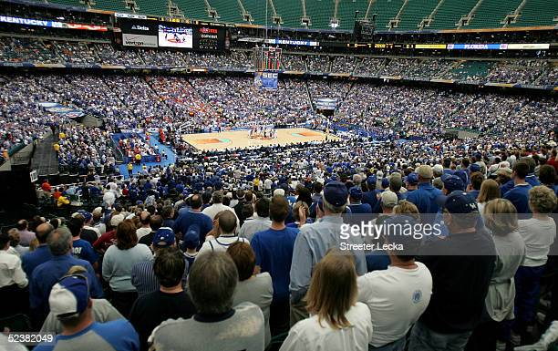The Florida Gators tip-off against the Kentucky Wildcats in the SEC Men's Basketball Championship game at the Georgia Dome on March 13, 2005 in...