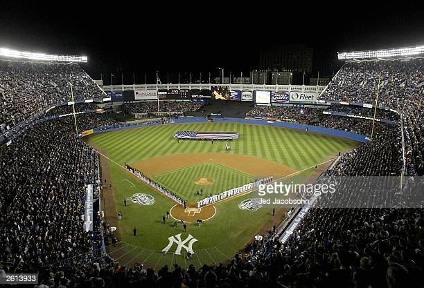 The Florida Marlins and the New York Yankees stand for the National Anthem before game 1 of the Major League Baseball World Series October 18 2003 at...